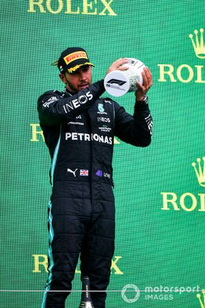 Lewis Hamilton, Mercedes, 3rd position, lifts his trophy on the podium
