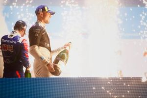 Alex Lynn, Mahindra Racing, third position, Jake Dennis, BMW I Andretti Motorsport, first position, spray Champagne on the podium
