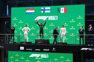 The Mercedes trophy delegate, Max Verstappen, Red Bull Racing, 2nd position, Valtteri Bottas, Mercedes, 1st position, with his trophy and Sergio Perez, Red Bull Racing, 3rd position, on the podium