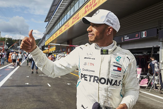 Pole man Lewis Hamilton, Mercedes AMG F1, gives a thumbs up to fans