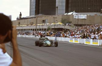 Michele Alboreto, Tyrrell 011 Ford, crosses the line for the win