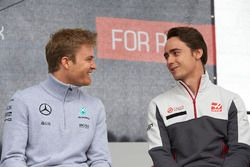 Nico Rosberg, Mercedes AMG F1 Team and Esteban Gutierrez, Haas F1 Team
