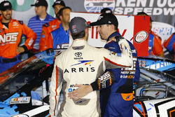 Third place Daniel Suarez, Joe Gibbs Racing Toyota talks to race winner Kyle Busch, Joe Gibbs Racing