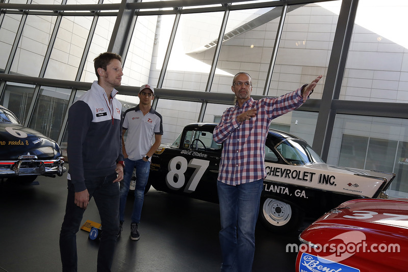 Former NASCAR driver Kyle Petty gives Romain Grosjean, Haas F1 Team, Esteban Gutierrez, Haas F1 a tour of the NASCAR Hall of Fame