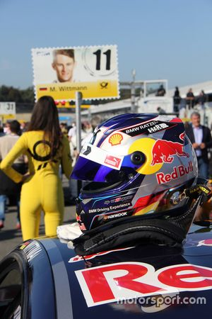 Grid girl of Marco Wittmann, BMW Team RMG, BMW M4 DTM and his helmet