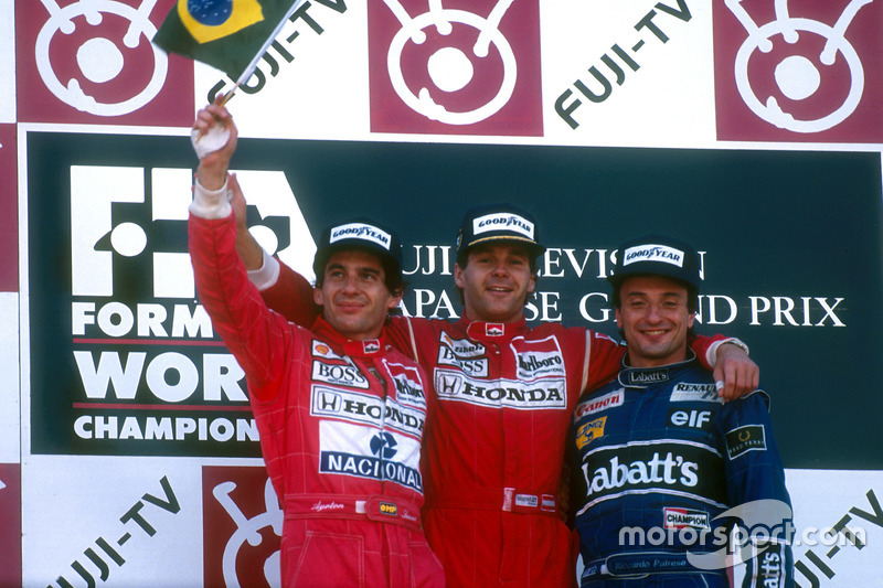 Podium: Race winner Gerhard Berger, McLaren, second place and World champion Ayrton Senna, McLaren; third place Riccardo Patrese, Williams
