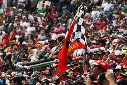 Ferrari flag with fans in the grandstand