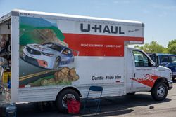 A U-Haul truck with the Acura TLX on the side
