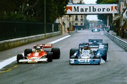 Jochen Mass, McLaren M23 Ford, overtakes Ronnie Peterson, Tyrrell P34 Ford, with Mario Andretti, Lotus 78 Ford, in pursuit