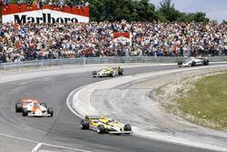 Alain Prost, Renault RE30 leads John Watson, McLaren MP4/1 Ford, Réne Arnoux, Renault RE30, Nelson Piquet, Brabham BT49C-Ford Cosworth