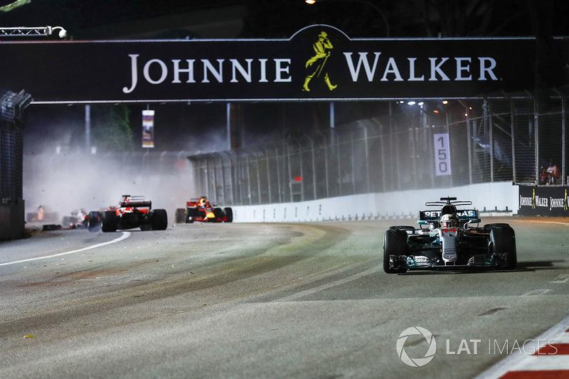 Lewis Hamilton, Mercedes AMG F1 W08, as Sebastian Vettel, Ferrari SF70H, Kimi Raikkonen, Ferrari SF70H, Max Verstappen, Red Bull Racing RB13, crash out behind them