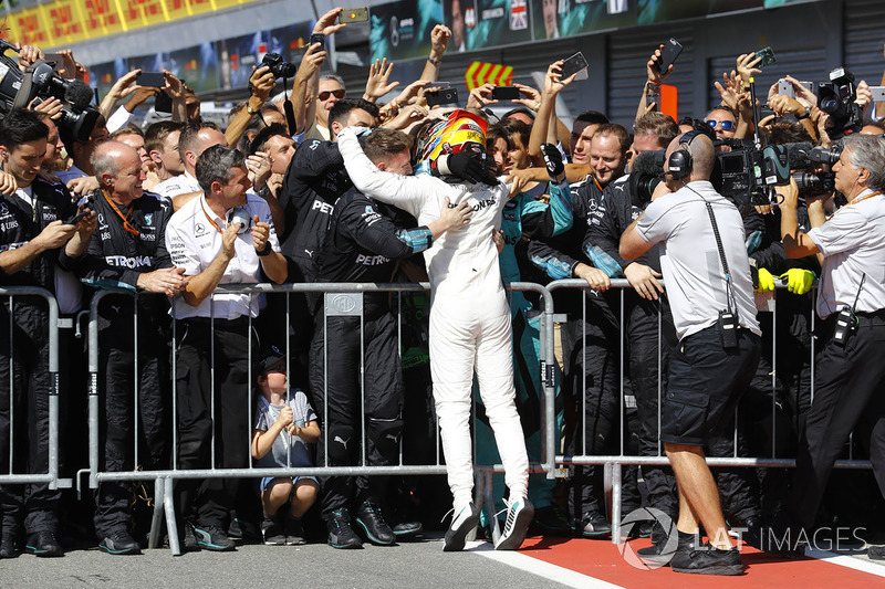 Lewis Hamilton, Mercedes AMG F1, celebrates, his team after winning the race