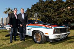 Allan Moffat and Colin Bond with the original 1977 winning Ford Falcons with the Peter Brock Trophy