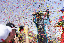 Sébastien Buemi, Renault e.Dams, and Lucas di Grassi, ABT Schaeffler Audi Sport, spray the champagne on the podium