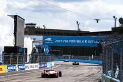 Felix Rosenqvist, Mahindra Racing, leads Lucas di Grassi, ABT Schaeffler Audi Sport, and Nick Heidfeld, Mahindra Racing, across the line to win the race