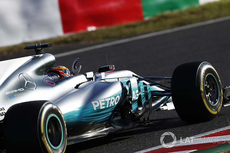 Lewis Hamilton, Mercedes AMG F1 W08, celebrates as he returns to the pits after winning the race