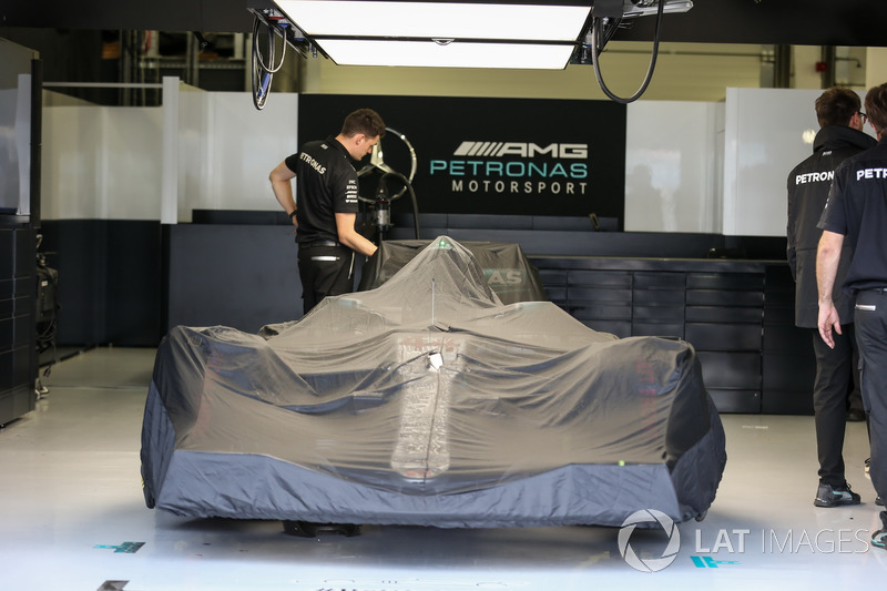 Mercedes-Benz F1 W08 under covers in the garage