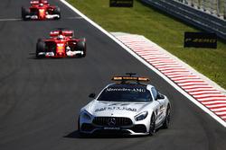 A safety car leads Sebastian Vettel, Ferrari SF70H, Kimi Raikkonen, Ferrari SF70H