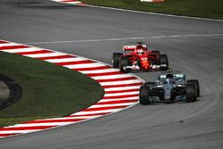 Valtteri Bottas, Mercedes-Benz F1 W08  and Sebastian Vettel, Ferrari SF70H