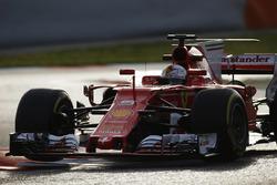 Sebastian Vettel, Ferrari SF70H, lifts a wheel over a kerb
