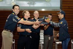 Daniel Ricciardo, Red Bull Racing prepares to drink champagne from shoes with VIPs at the ExxonMobil headquarters