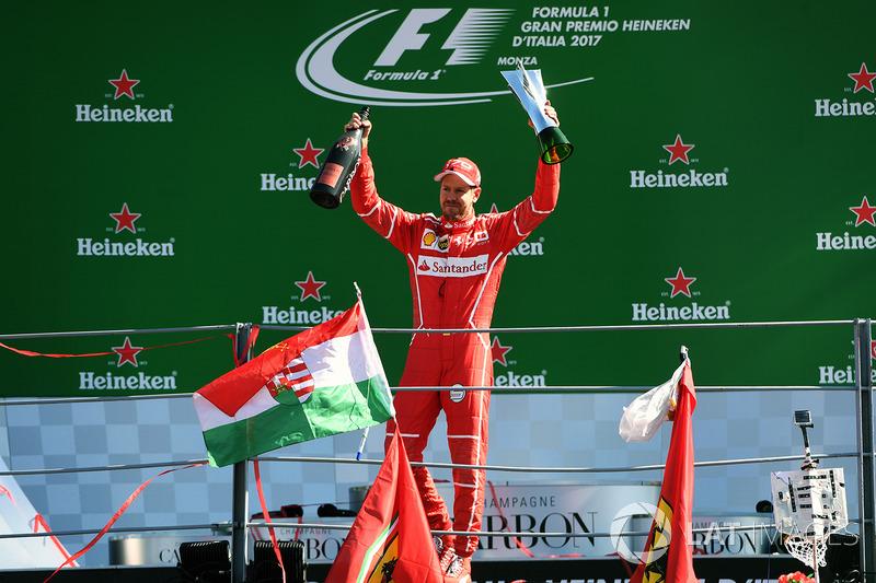Third place Sebastian Vettel, Ferrari celebrates on the podium