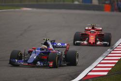 Carlos Sainz Jr., Scuderia Toro Rosso STR12, leads Kimi Raikkonen, Ferrari SF70H