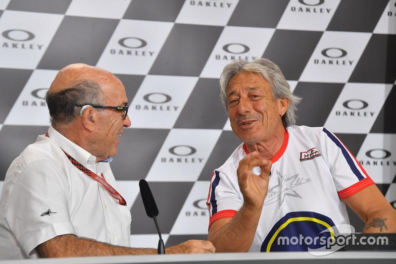 Marco Lucchinelli en Carmelo Ezpeleta, CEO van Dorna Sports