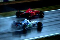 Michael Schumacher, Ferrari past Gerhard Berger, Benetton