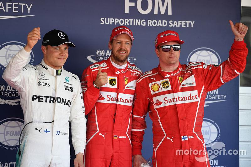 Ganador de la pole Sebastian Vettel, Ferrari, segundo lugar Kimi Raikkonen, Ferrari y el tercero Valtteri Bottas, Mercedes AMG F1