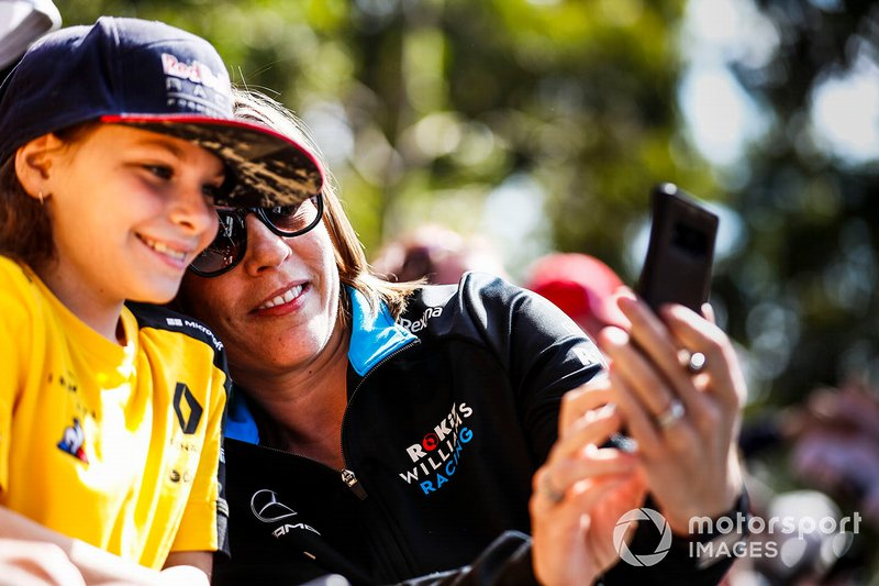 Claire Williams, Deputy Team Principal, Williams Racing poses for a selfie with a fan