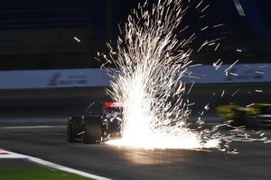Sparks fly from the rear of Antonio Giovinazzi, Alfa Romeo Racing C38