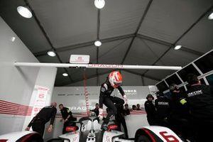 Felipe Nasr climbs out of his Dragon Racing, Penske EV-3 in the garage