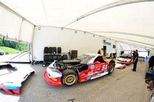 Crews work on the #51 TA Chevrolet Corvette driven by Tom Ellis of Derhaag Motorsports