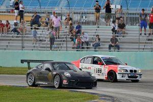 #17 MP1A Porsche GT3 Cup driven by Juan Fayen, Lino Fayen, and Angel Benitez Jr. #169 MP2B BMW M3 driven by Andor Kovacs & Peter London of TLM USA