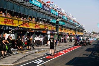 Romain Grosjean, Haas F1 Team VF-19, arrives at his garage