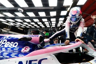 Sergio Perez, Racing Point RP19, climbs into his car in the garage