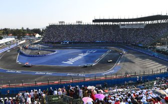 The fans watch the field pass through the stadium section of the track