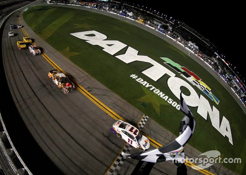 Race winner Denny Hamlin, Joe Gibbs Racing Toyota take the checkered flag