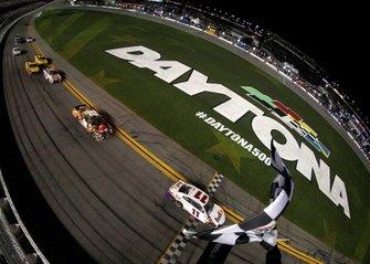 Race winner Denny Hamlin, Joe Gibbs Racing Toyota take the checkered flag