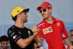 Daniel Ricciardo, Renault, and Sebastian Vettel, Ferrari, on stage