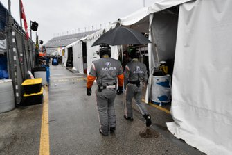 Acura crew staying dry.