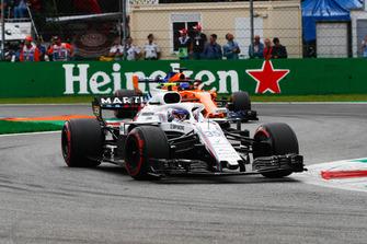Sergey Sirotkin, Williams FW41, leads Fernando Alonso, McLaren MCL33
