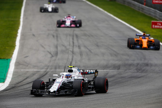 Sergey Sirotkin, Williams FW41, leads Fernando Alonso, McLaren MCL33, and Sergio Perez, Racing Point Force India VJM11