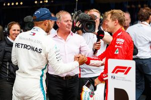 Lewis Hamilton, Mercedes AMG F1 and Sebastian Vettel, Ferrari in parc ferme with Martin Brundle, Sky TV