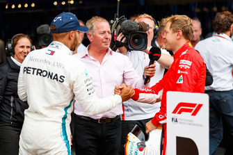 Lewis Hamilton, Mercedes AMG F1 and Sebastian Vettel, Ferrari in parc ferme with Martin Brundle, Sky TV