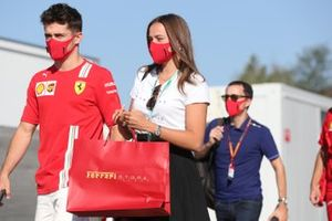 Charles Leclerc, Ferrari, and girlfriend Charlotte Sine arrive at the circuit