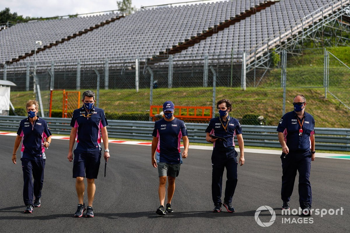Sergio Perez, Racing Point, walks the track with team members