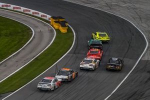 Brandon Jones, Joe Gibbs Racing, Toyota Supra Menards/Inspire leads into Turn 1