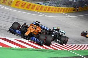 Carlos Sainz Jr., McLaren MCL35 leads Valtteri Bottas, Mercedes F1 W11 EQ Performance